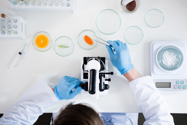 A woman places the subject in a petri dish